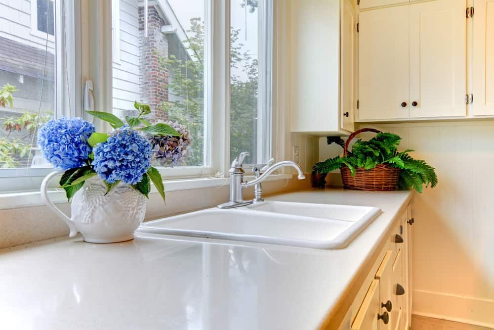white kitchen sink with brand new moen faucet