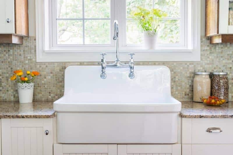 White Farmhouse Kitchen Sink Near Window